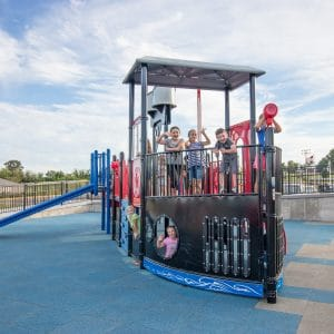 Thumbnail of Children playing on a playground that looks like a riverboat.