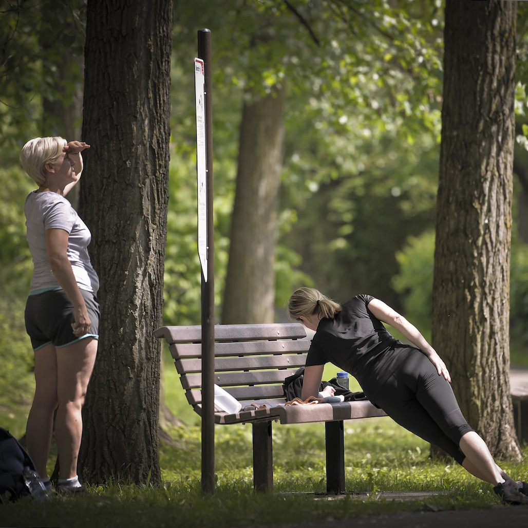Two people working out at a park.