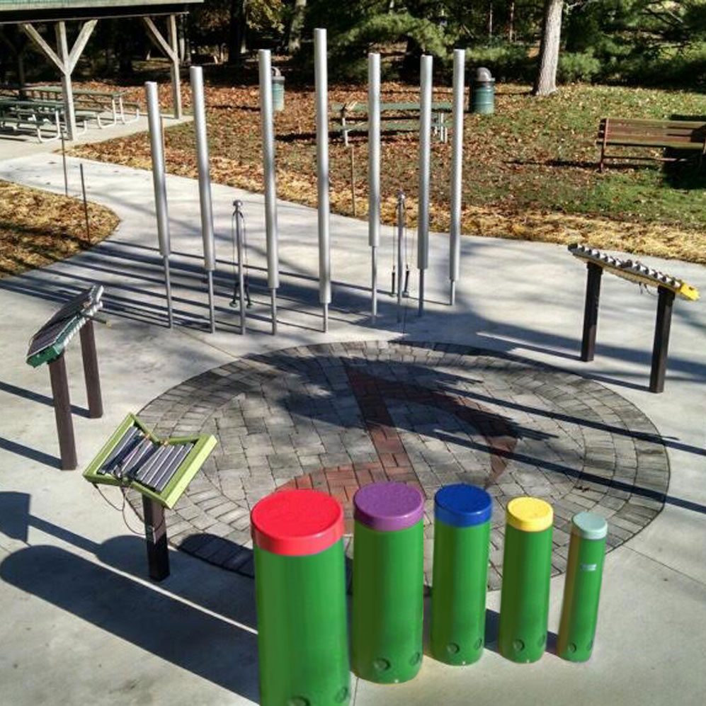 Outdoor musical instruments at a community group playground.