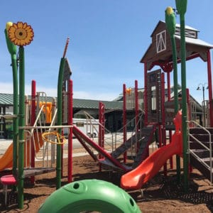 Thumbnail of A small red slide on a barnyard themed playground