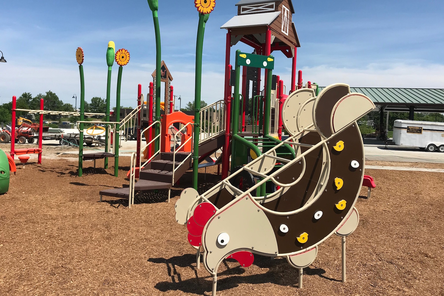 Rooster-shaped glider on a playground