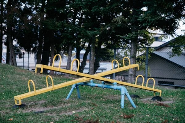 Old yellow metal seesaw.