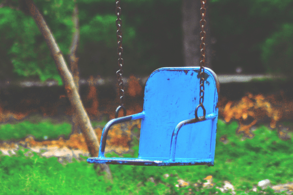 Blue metal accessible swing.